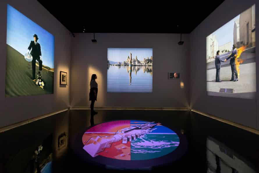 A room full of Hipgnosis artwork for Pink Floyd's Wish You Were Here.