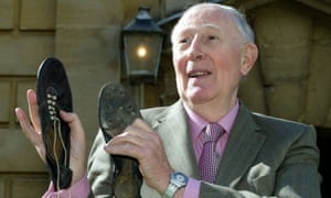 Sir Roger Bannister pictured in 2004 with his old running shoes.