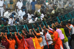 Kolkata, IndiaMembers of the Bhartiya Janata Party try to breakthrough a police barricade during a protest against the worsening law and order situation in the state