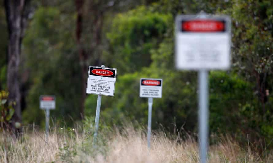 Signs warn of an underground gas pipeline near Dalby, 180 km (112 miles) west of Brisbane