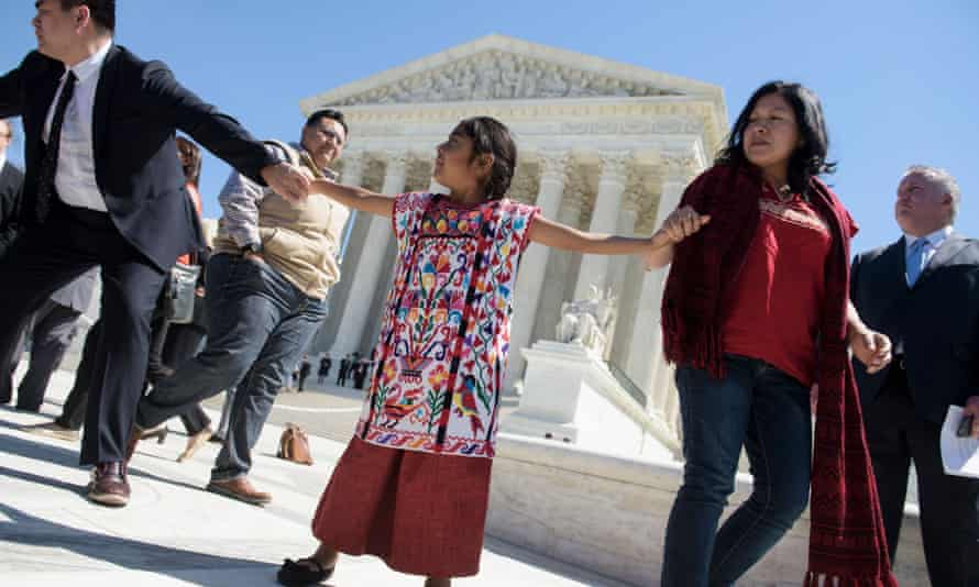 Sophie Cruz of Los Angeles, and other supporters of President Obama's immigration reforms leave the US supreme court on Monday.