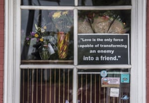 A sign hangs in the window at the Red Hen, a Virginia restaurant where Sarah Sanders was asked to leave during her meal.