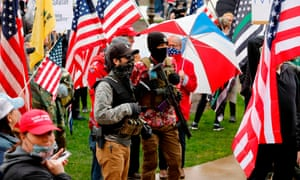 In April, protesters wearing the Trump insignia and semi-automatic rifles stormed the state capital in Lansing, Michigan.