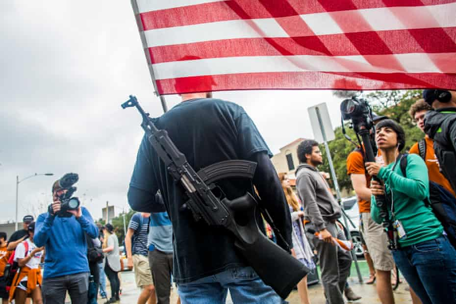 Gun activists march close to The University of Texas campus December 12, 2015 in Austin, Texas. In addition to the event put on by DontComply.com, a gun activist organization, the group also held an open carry walk earlier in the day.