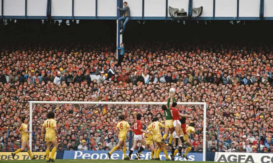 Two Liverpool fans climb up to get a better view of the action during the 1985 FA Cup semi final against Manchester United at Goodison Park