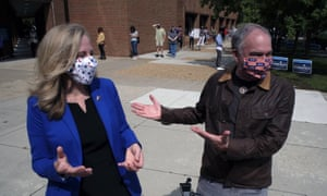 Senator Tim Kaine (R) jokes with congresswoman Abigail Spanberger (both represent Virginia) after she arrived at a voting station to vote early in the 2020 election.