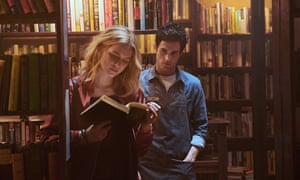 Elizabeth Lail and Penn Badgley in You.