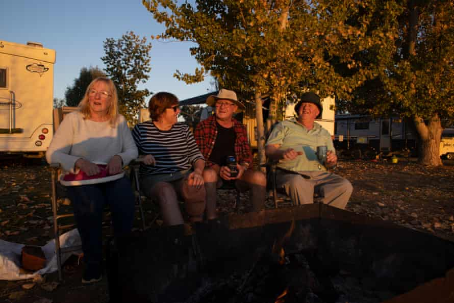 Campers from left to right Mary Knight, Carmel Rigby, Matthew Rigby and Doug Knight watch the sunset at Copi Hollow camping area near Menindee NSW.