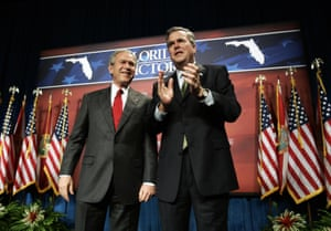 Then-president George W. Bush is introduced by his brother, then-governor Jeb, at a fundraiser in Orlando in 2006.