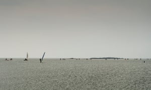 Windsurfers with walkers on the horizon at the Marine Lake