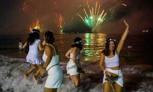 Friends take a dip at Copacabana.