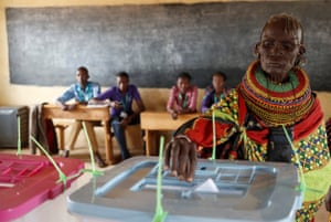 Baragoi, Kenya A Turkana tribeswoman casts her ballot at a polling station. The presidential election is expected to be a tight contest between Uhuru Kenyatta and Raila Odinga