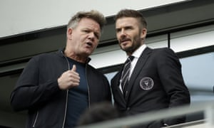David Beckham talks to the chef Gordon Ramsay during his Inter Miami team's inaugural match in Major League Soccer.