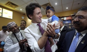 Liberal leader Justin Trudeau holds a baby during a campaign stop in Brampton, Ontario, on Friday.