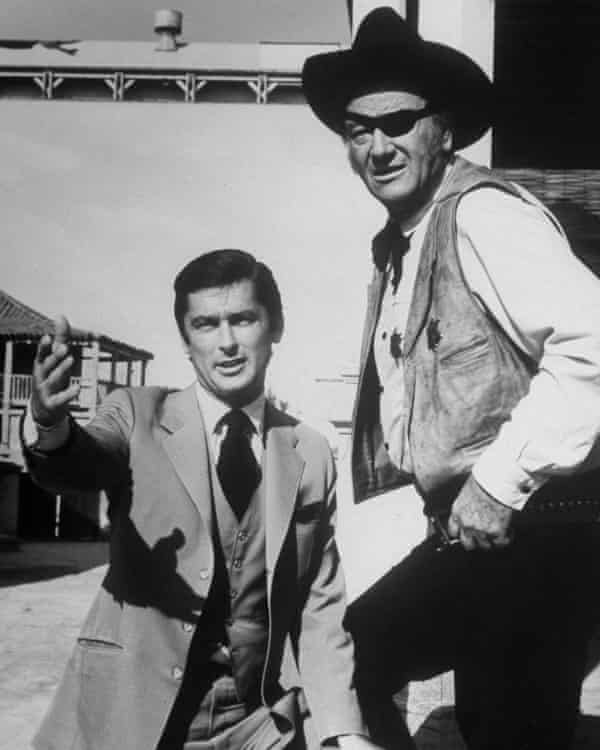 Robert Evans on set with with the actor John Wayne in 1969.