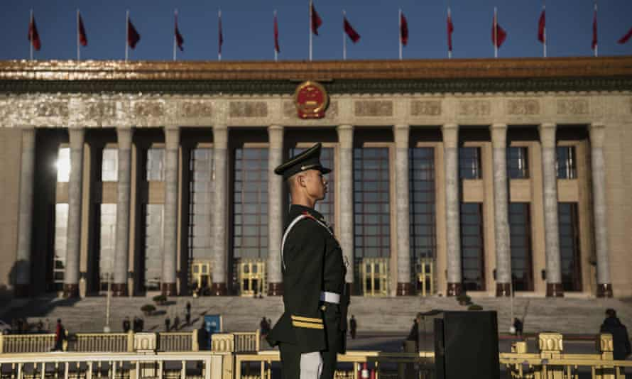 A member of the People's Armed Police stands guard at The Great Hall Of The People in Beijing, China