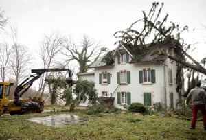 Val-de-Ruz, Switzerland. A tree falls on to a house during Storm Ciara