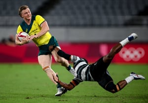 Henry Hutchison of Australia is tackled by Napolioni Bolaca of Fiji during the men's rugby sevens quarter-final match