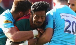 Manu Tuilagi of Leicester struggles to pass two opponents in his team's defeat to Worcester.