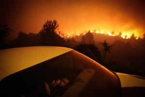 A child sits inside a car close by a forest fire in Oliveira de Frades, Portugal, on 7 September 2020