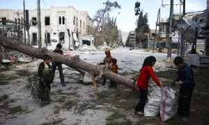 Children collecting wood in the besieged town.