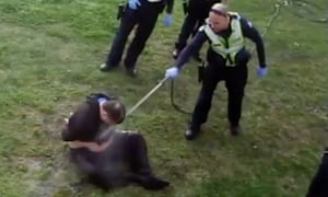 Melbourne police spray a disability pensioner in teh face with water from a high-pressure garden hose.