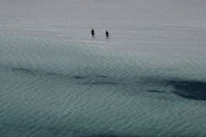 Tourists walk on Balos beach and its lagoon on the island of Crete