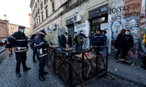 Police officers carry out checks in San Lorenzo district for the restrictions during the last weekend before the new measures against the Covid-19 pandemic come into force, in Rome, Italy, 13 March 2021.