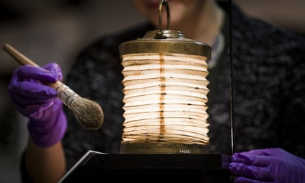 Museum curator prepares a Turkish fanoos lamp carried by Florence Nightingale during the Crimean War