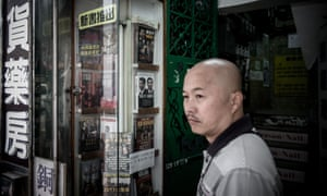 Man stands by a display of books featuring prominent political figures in Hong Kong on Monday.