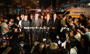 New York police commissioner James O'Neill (center right) and mayor Bill de Blasio (center left) speak at a press conference