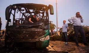 Forensic investigators examining a bus damaged in last month's bomb blast in Jerusalem