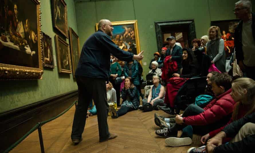 A National Gallery educator talks to visitors
