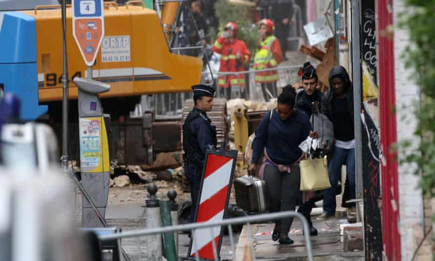 Residents recover their belongings from collapsed buildings in Marseille.