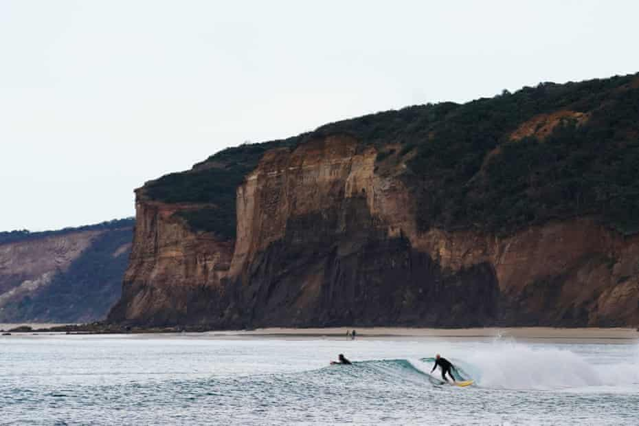 Surfers at Bells beach in Torquay, Victoria