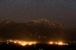 Anti-frost candles burn in a vineyard in Jenins, Switzerland, last week