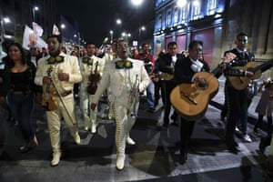 A group of mariachis and supporters of the coalition lead songs in Mexico City