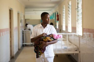 Nurse-midwife Daniel Paul at work in his ward for women who have had caesareans, or who have been admitted with pregnancy complications at Kiomboi district hospital, Kiomboi, Tanzania.