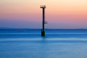 A calm and balmy evening on the SolentThe sun sets on a calm and balmy evening while a new structure appears silhouetted in the Solent Photograph: Jon Neil/GuardianWitness