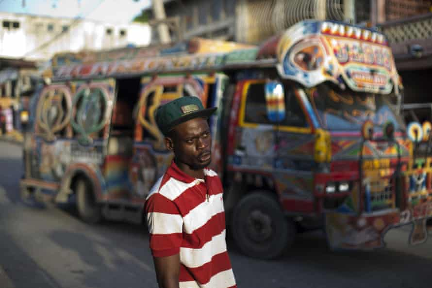 A minibus worker seeks passengers for his tap-tap in the Grand Rue market area of Port-au-Prince.
