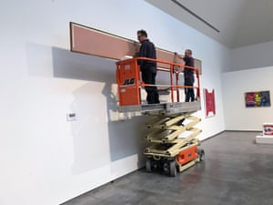 Staff at the museum remove artwork by Jules Olitski, who was born in Gomel, Russia