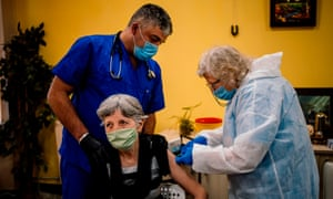 An elderly woman receives a vaccination at a care home in Sofia on Wednesday.
