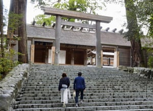 A couple climbs the steps of Ise Grand Shrine, or Ise Jingu, in Ise city, central Japan.