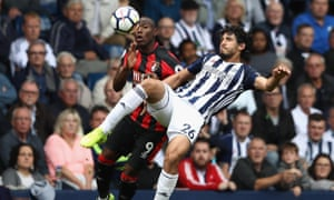 West Brom's scorer Ahmed El-Sayed Hegazi clears from Bournemouth's Benik Afobe at The Hawthorns.