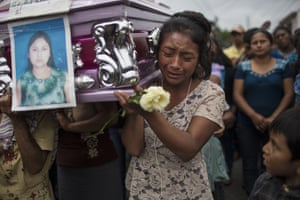 Yoselin Rancho carries the coffin of her best friend, Etelvina Charal, who died in the volcanic eruption