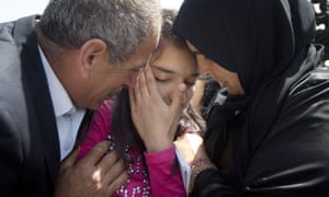 Palestinian 12-year-old Dima al-Wawi with her mother Sabha al-Wawi, right, and her father Ismail al-Wawi