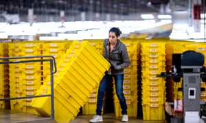 A worker at a fulfillment center at the 855,000 sq ft Amazon fulfillment center in Staten Island.