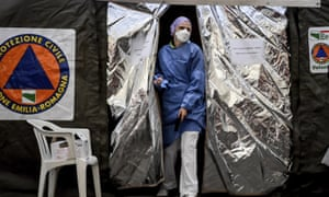 A paramedic emerges from a tent set up by the Italian Civil Protection outside the emergency ward of the Piacenza hospital, Emilia-Romagna.