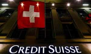The Credit Suisse logo below the Swiss national flag at Federal Square in Bern, Switzerland
