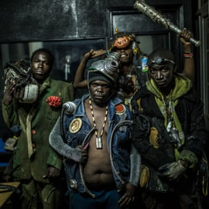 Musicians from Kibera pose for a photo backstage in their costumes during a music video launch in by Wakuu and Dandora Music Groups, the video was shot and directed by Stephen Okoth, who is also known as Ondivow – a filmmaker born and living in Kibera. He is also the creator of the costumes
